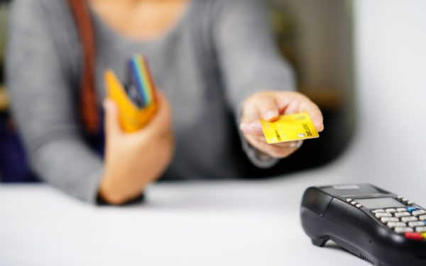 Hand the Credit card to cashier