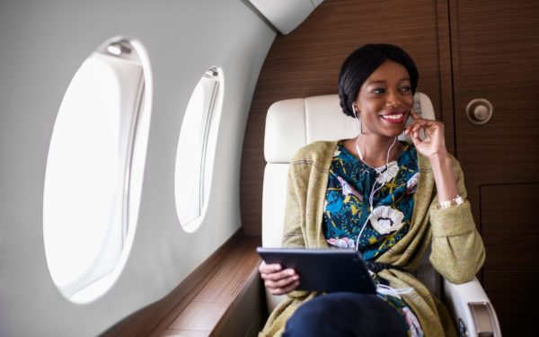 Woman in private jet airplane